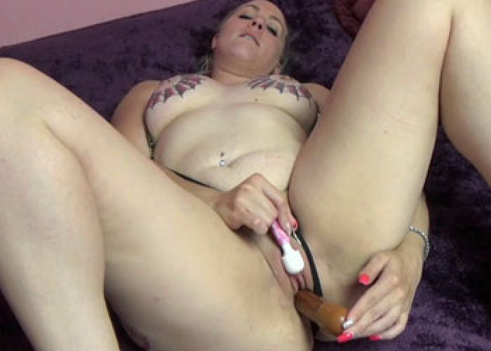 Selena uses two toys on her wet pussy
